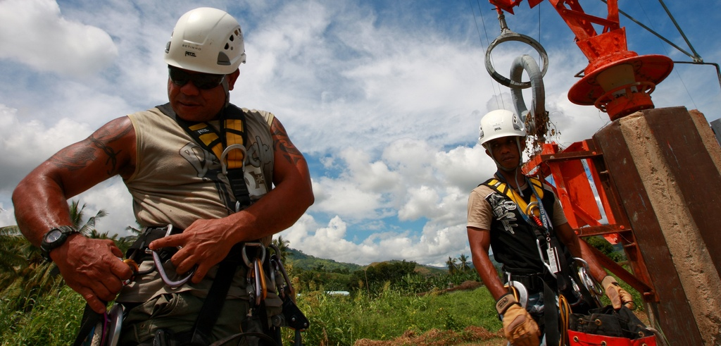 UN staff repair a radio tower in Timor-Leste. (Flickr/UN Photo)