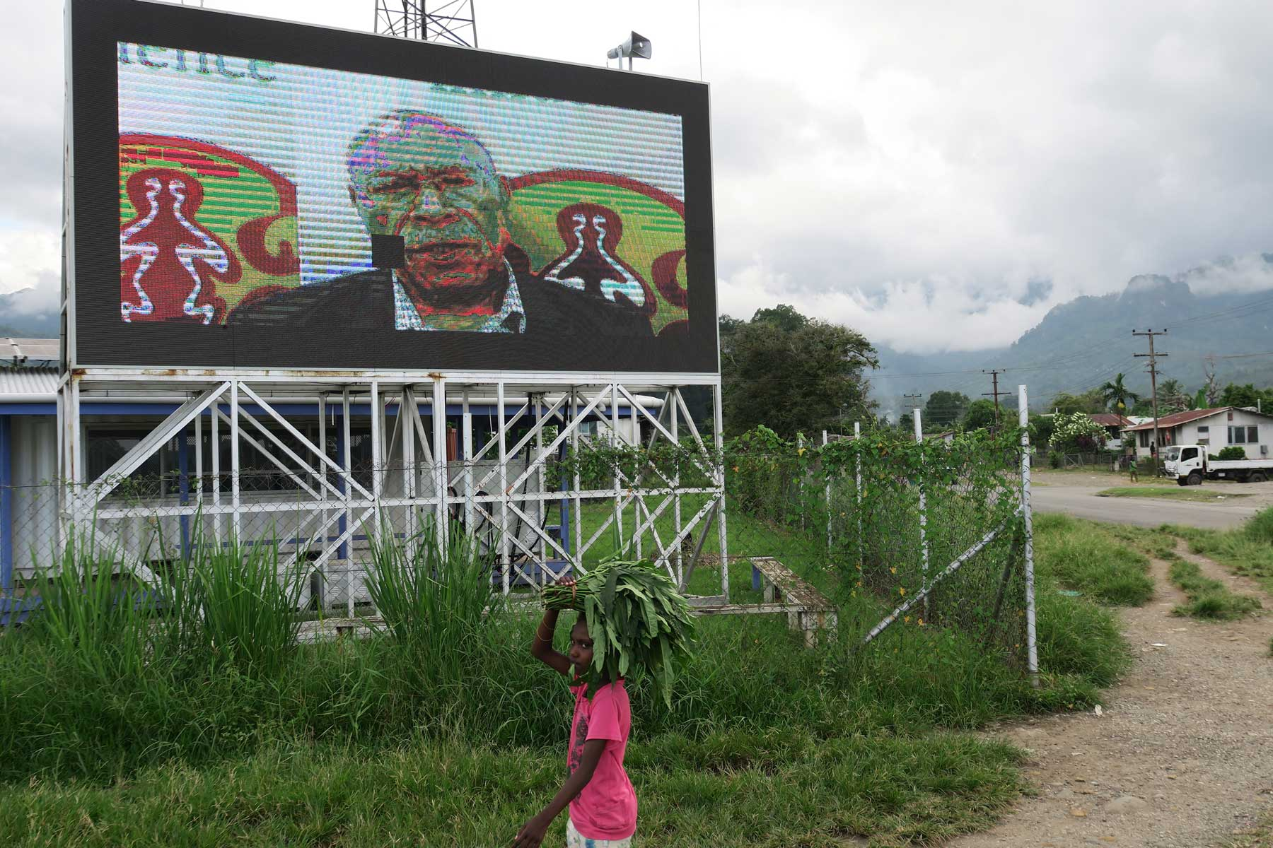 A television screen outside the market in Arawa is used to communicate updates on the referendum process
