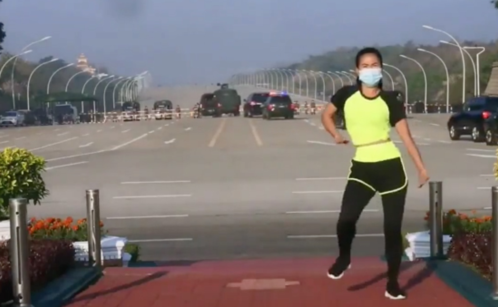 A screenshot of Khing Hnin Wai's exercise video, apparently capturing the moment of the coup in Myanmar.