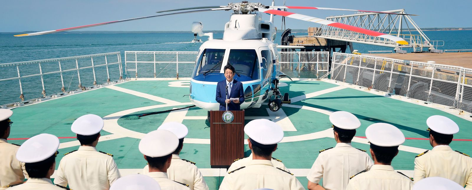 Japan's Prime Minister Shinzo Abe addresses sailors during a ship tour at Fort Hill Wharf in Darwin. (Photo: Michael Franchi/AFP/Getty)