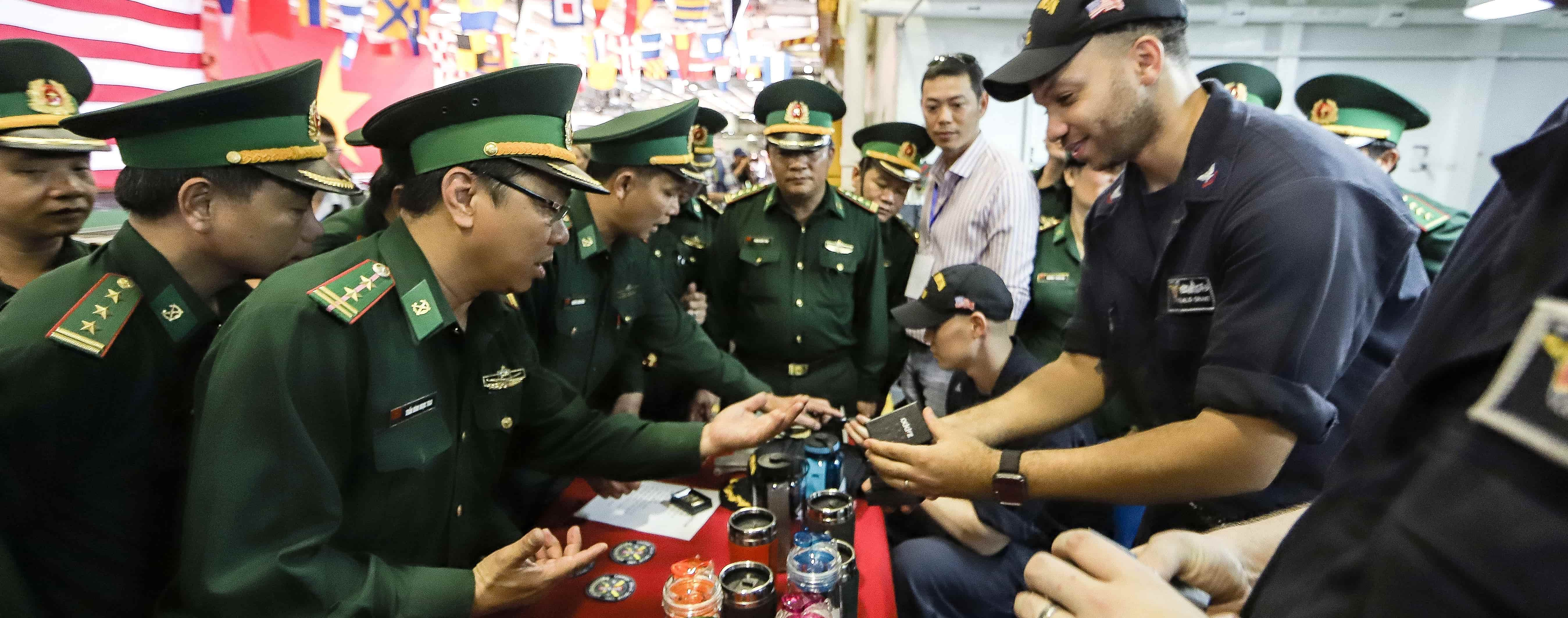 Vietnamese military officers aboard the USS Carl Vinson. (Photo: Getty Images)