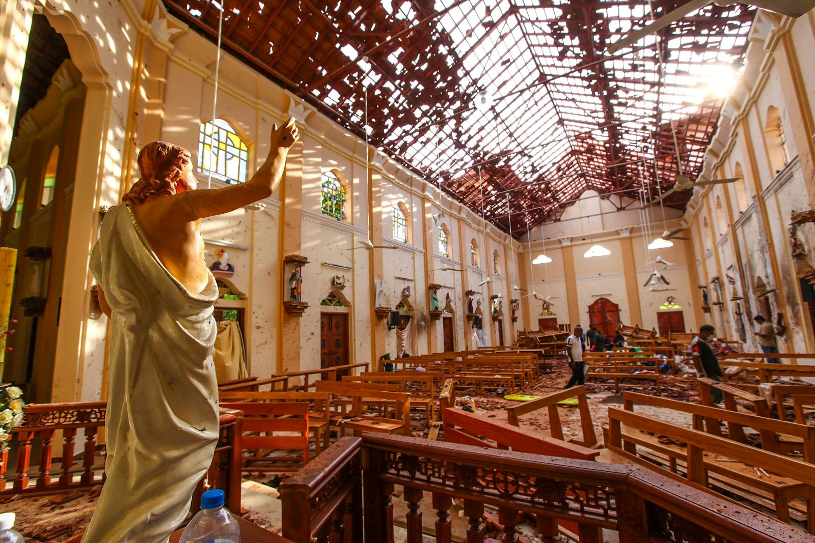Officials inspect the damaged St. Sebastian's Church after co-ordinated explosions on April 21, 2019 in Negombo, north of Colombo, Sri Lanka. (Photo: Stringer/Getty)