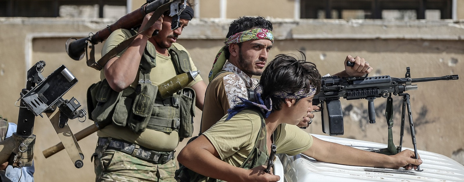 Members of opponent groups linked to Free Syrian Army in Aleppo, Syria in October last year.  (Photo: Emin Sansar/Getty Images)