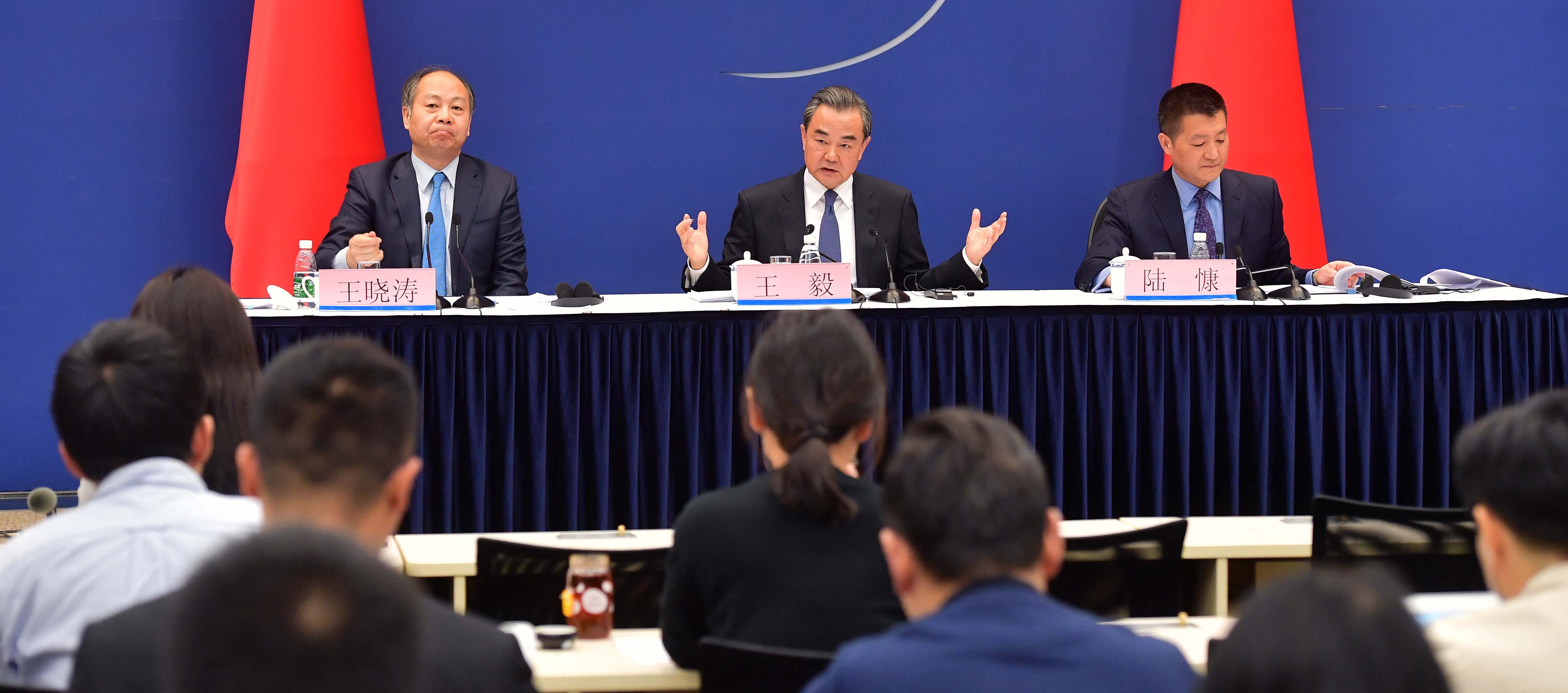 Wang Xiaotao and Wang Yi attend a press conference during The Belt and Road Forum in Beijing, April 2017. (Photo: VCG/Getty)