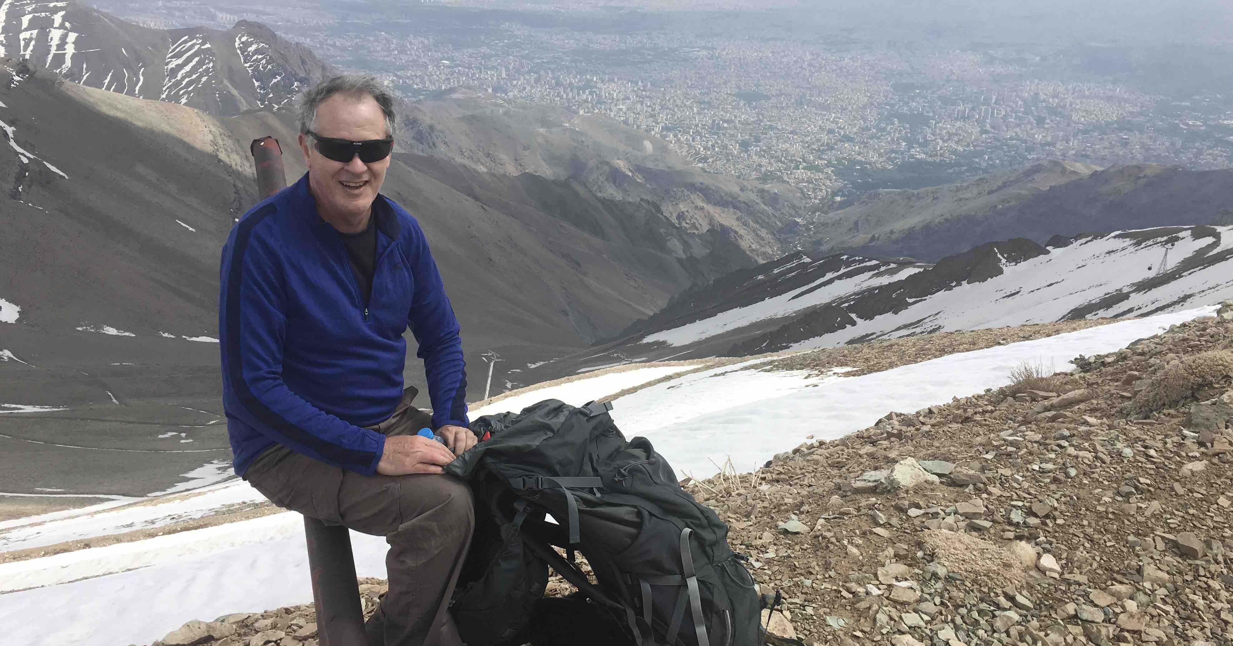Your hardy correspondent atop Mt Tochal, the sprawl of Tehran below.