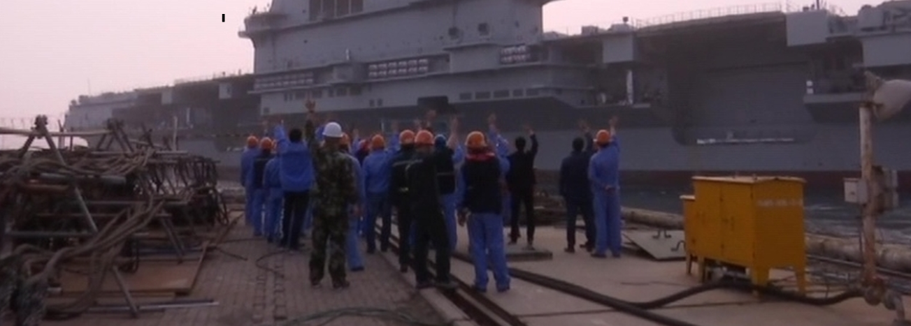 A still from a Chinese TV report about the first voyage of the new aircraft carrier.