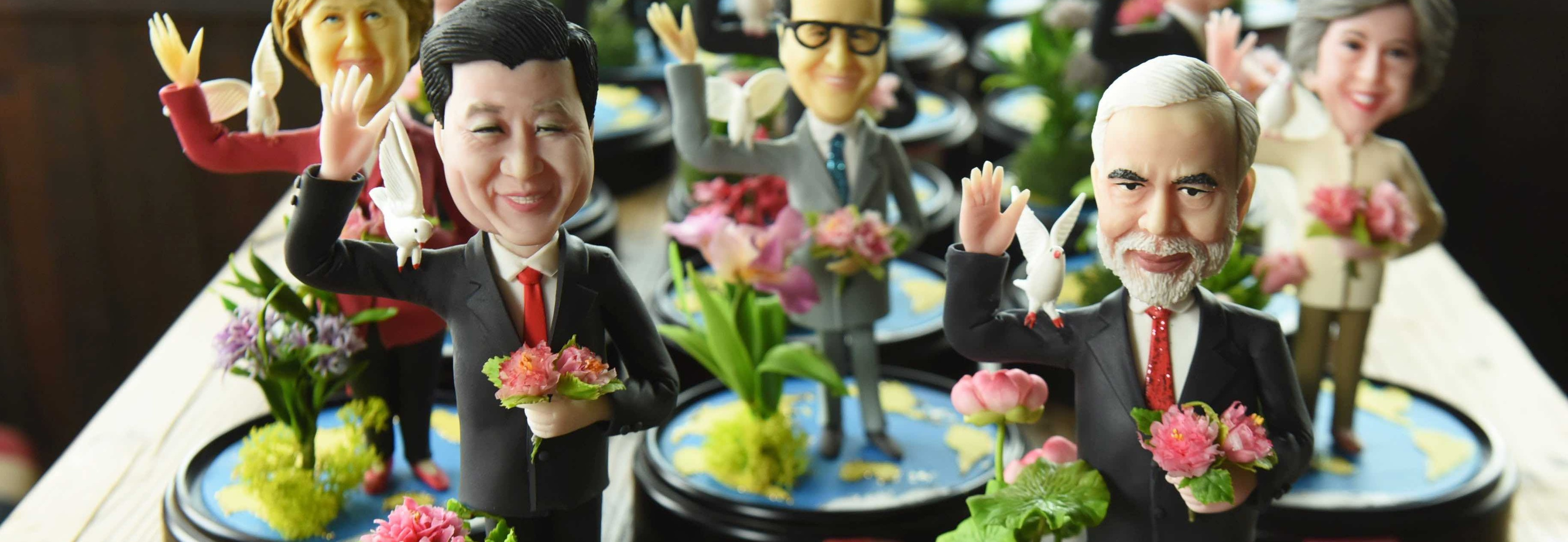 Figurines of Chinese President Xi Jinping and Indian Prime Minister Narendra Modi made by artist Wu Xiaoli for the 2016 G20 Hangzhou Summit. (Photo: Long Wei/Getty Images)